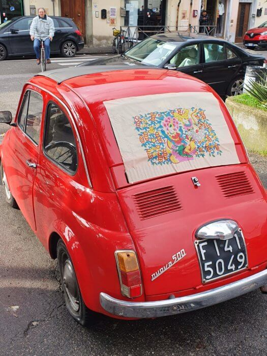 Fig. 7: A bright red Fiat 500 remains parked in Piazza dell'Immaginario throughout the art performance.