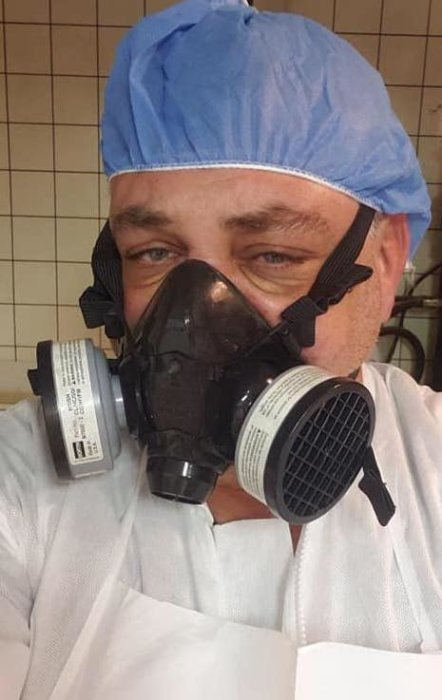 A men wearing personal protection equipment
